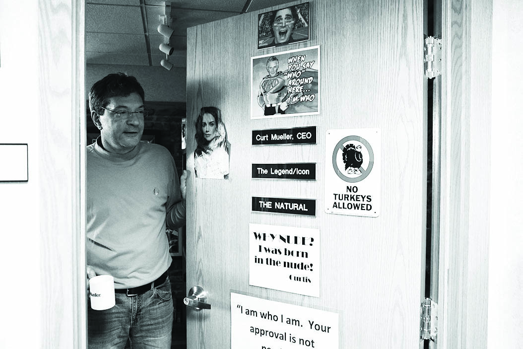 Mueller's son Brett shows the door of his father's office at Mueller Sports Medicine.