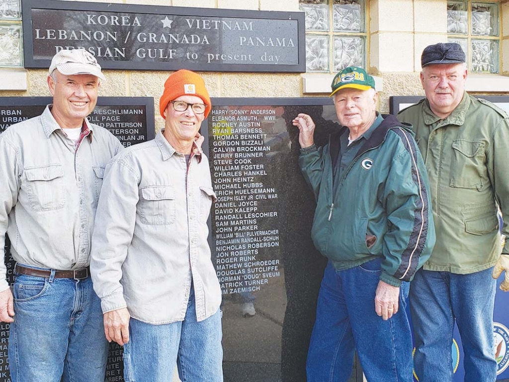 Pictured, left to right: Tom Bennett, Dan Joyce, Joe Bomkamp, and Gary Ballweg. Their names are among the many being added to the memorial in...
