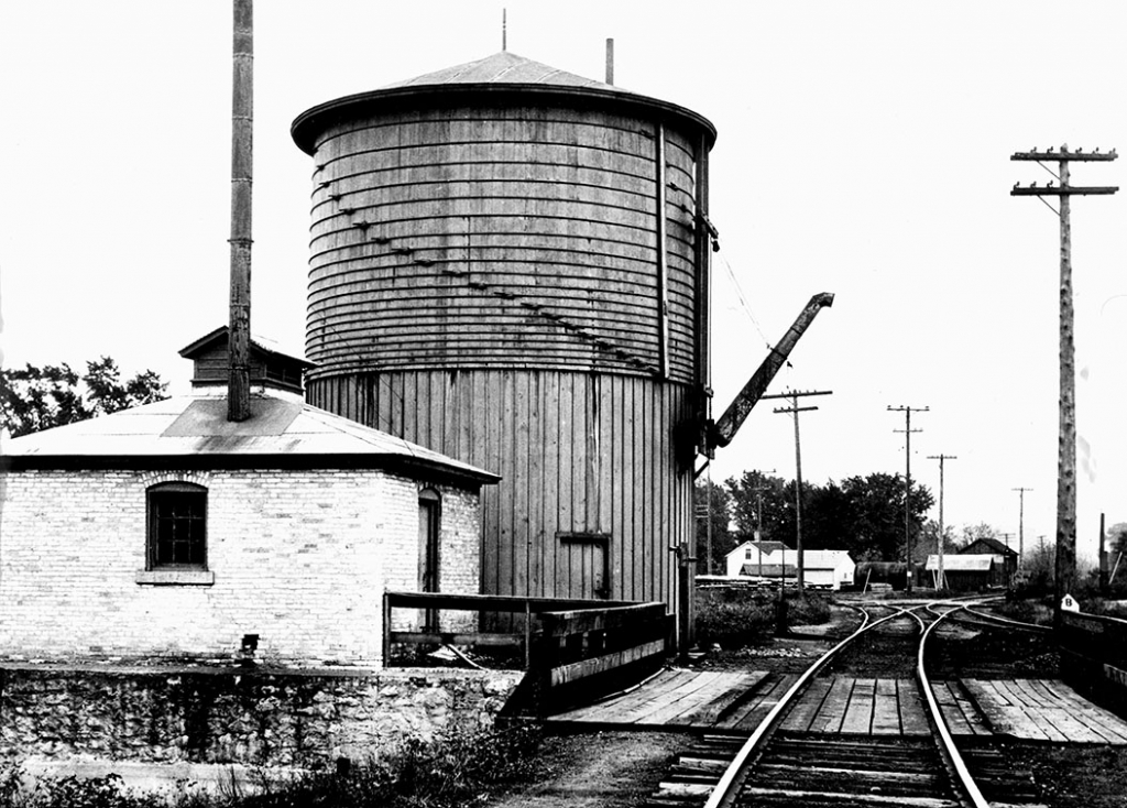 Early railroad steam engines needed to fill up with water every 20 to 30 miles so a water tank was needed in the railroad town of Mazomanie. A water...